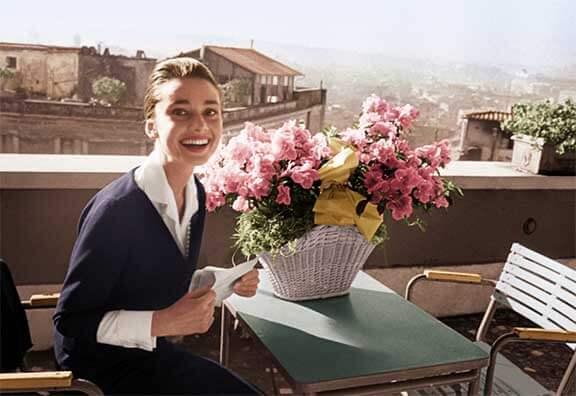 Audrey Hepburn on the terrace of the Hotel Hassler, in Rome, with the telegram announcing her best-actress award, for The Nun's Story, from the New York Film Critics Circle, 1960