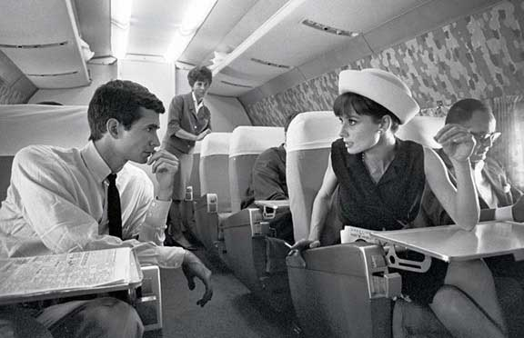 Flanked by Anthony Perkins and Dino De Laurentiis on a 1962 flight to Taormina