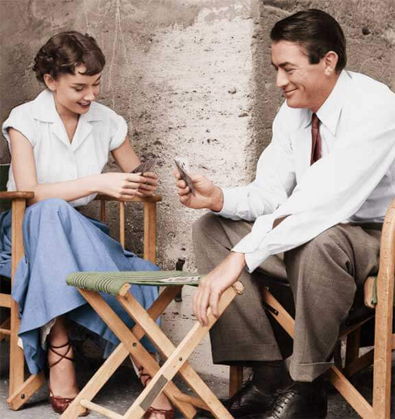 Playing cards with Gregory Peck in a scene from Roman Holiday, 1953