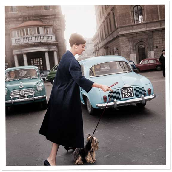 Audrey Hepburn and Mr. Famous leave the Hotel Hassler, on the Piazza Trinità dei Monti, 1960