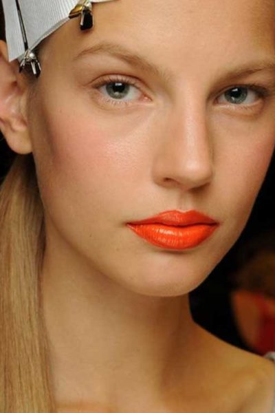 Orange is the new red… and here's how to wear this lipstick trend in real life
