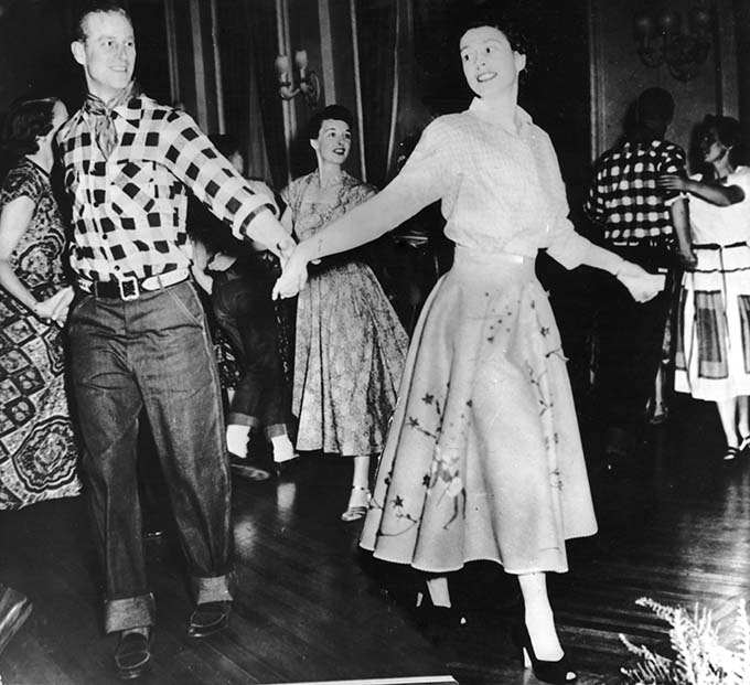 Queen Elizabeth II (then Princess Elizabeth) dances with her husband,the Duke of Edinburgh, at a square dance held in their honour in Ottawa, by Governor General Viscount Alexander, 17th October 1951. The dance was one of the events arranged during their Canadian tour. (Photo by Keystone/Hulton Archive/Getty Images)
